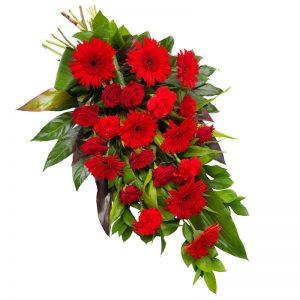 Röd sorgbukett med rosor, gerbera, nejlikor och säsongsgrönt.