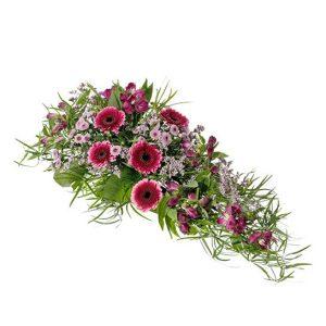 Låt sorgdekoration i cerise och lila, med alstroemeria, germini, santini och grönt. Skicka den med ett blombud från Interflora direkt till aktuell begravning - beställ enkelt online.