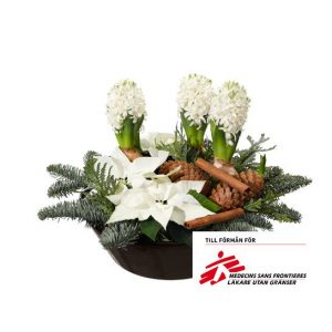 Julgrupp hyacinter, julstjärnor, nobilis, kottar och kanelstänger. Julgruppen finns att beställa online hos Interflora.