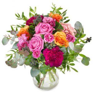 Höstbukett med blandade blommor i rosa, orange och grönt. Ur Euroflorists utbud av höstblommor.