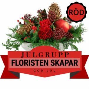 Julgrupp i rött, grönt och brunt - floristen använder sig av tillgängliga julblommor när hen arrangerar julgruppen. Skicka den med ett bud från Florister i Sverige!