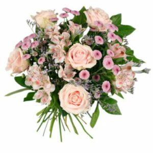 Bukett med blandade blommor i rosa toner. Finns hos Florister i Sverige.